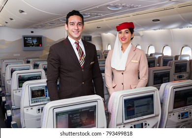 Dubai, UAE - NOVEMBER 12, 2017: Emirates flight attendants. Emirates Airbus A380 travel. Stewardess dress. Flight attendant portrait. Dubai travel.