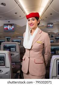Dubai, UAE - NOVEMBER 12, 2017: Emirates beautiful flight attendant. Emirates Airbus A380 travel. Stewardess dress. Flight attendant portrait.
