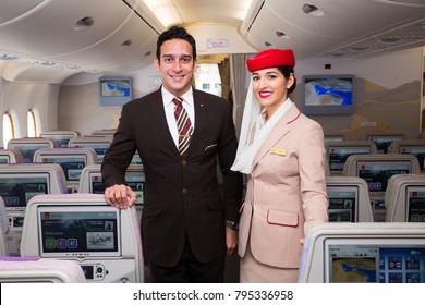 Dubai, UAE - NOVEMBER 12, 2017: Emirates flight attendants. Emirates Airbus A380 travel. Stewardess dress. Flight attendant portrait. Dubai travel.
