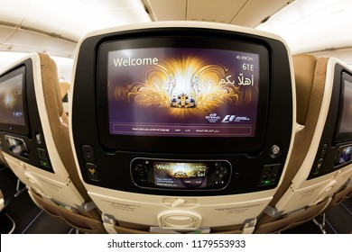Dubai, UAE - NOVEMBER 13, 2017: Etihad Airways Inflight entertainment system IFE screen. Airbus A380. Etihad economy class seats. Travelling with Etihad airways. Inflight entertainment system display.