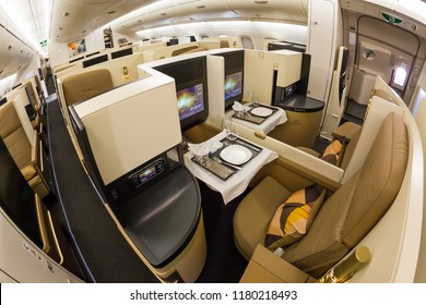 Dubai, UAE - NOVEMBER 13, 2017: Etihad Airways business class luxury seats. Business class seat. Airbus A380. Onboard dining. Luxury travel. Travelling with Etihad Airways. Business class flight.