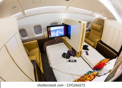 Dubai, UAE - NOVEMBER 13, 2017: Etihad Airways first class luxury seats. First class seat. Airbus A380. Flat bed. Luxury travel. Travelling with Etihad Airways. Business class flight.