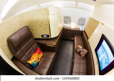 Dubai, UAE - NOVEMBER 13, 2017: Etihad Airways first class luxury seats. First class seat. Airbus A380. Luxury travel. Travelling with Etihad Airways. Business class flight. Inflight entertainment.
