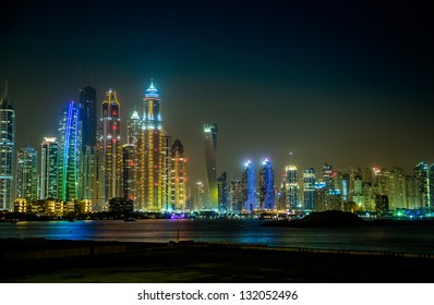 DUBAI, UAE - NOVEMBER 13: Dubai downtown night scene with city lights, luxury new high tech town in United Arab Emirates architecture  on November 13, 2012 in Dubai, UAE. . Dubai Marina cityscape, UAE