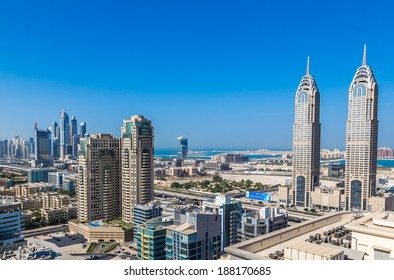 DUBAI, UAE - NOVEMBER 13: Modern skyscrapers in Dubai (emirate and city), UAE. Dubai now boasts more completed skyscrapers higher than 0,8 - 0,25 km than any other city on 13 November 2013  in Dubai.