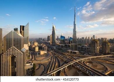 DUBAI, UAE - NOVEMBER 14, 2015: Burj Khalifa tallest building in the world. Dubai futuristic cityscape, sunset skyline. Dubai skyscrapers. Dubai road traffic. Dubai Downtown views. Dubai metro.