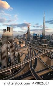 DUBAI, UAE - NOVEMBER 14, 2015: Dubai evening skyline. Sunset cloudscape. Burj Khalifa tallest building in the world. Dubai skyscrapers construction. Urban sunset cloudscape. Dubai futuristic.