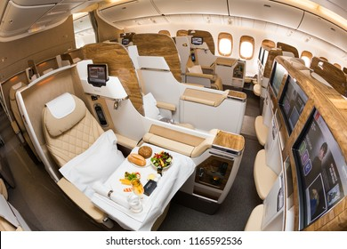 Dubai, UAE - NOVEMBER 14, 2017: Emirates new business class. Emirates luxury travel. Boeing 777. Onboard dining, food. Renewed business class cabin. Brand new design. Inflight entertainment system IFE