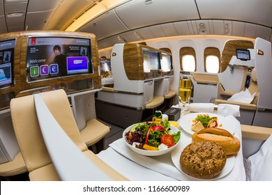 Dubai, UAE - NOVEMBER 14, 2017: Onboard dining, food. Airline catering. Emirates new business class. Emirates luxury travel. Boeing 777. Renewed business class cabin. Inflight entertainment system IFE