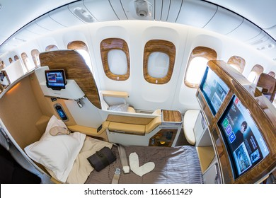 Dubai, UAE - NOVEMBER 14, 2017: Emirates new business class. Emirates luxury travel. Boeing 777. Renewed business class cabin. Brand new design. Inflight entertainment system screen. UAE airline.