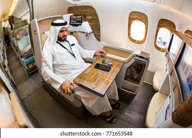 Dubai, UAE - NOVEMBER 14, 2017: Arab sheikh businessman enjoys new Emirates business class. Emirates luxury travel. Emirates renewed business class cabin. Boeing 777.