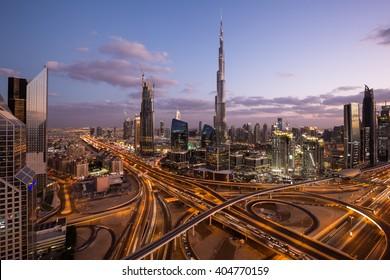 DUBAI, UAE - NOVEMBER 14: Burj Khalifa the tallest building in the world. Dubai Downtown cityscape. Dubai evening skyline, busy roads, sunset on November 14, 2015 in Dubai