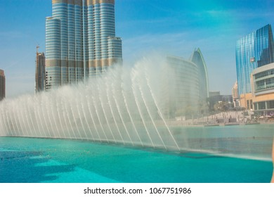 DUBAI, UAE - NOVEMBER 14: High rise buildings and fountains nov 14. 2012  in Dubai, UAE.  Burj Khalifa, the tallest building in the world