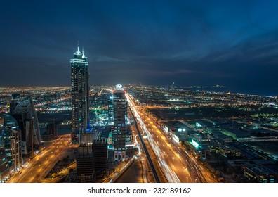 DUBAI, UAE - November 14: JW Marriott Marquis Dubai, UAE, as seen on November 14, 2014. It is the worlds tallest hotel, a 72-storey, 355 m (1,165 ft) twin-tower skyscraper complex.