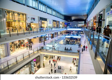 DUBAI, UAE - NOVEMBER 14: Shoppers at Dubai Mall on Nov 14, 2012 in Dubai. At over 12 million sq ft, it is the world's largest shopping mall based on total area and 6th largest by gross leasable area.