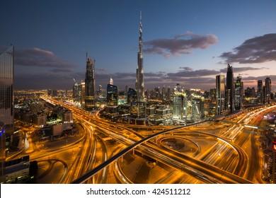 DUBAI, UAE - NOVEMBER 14: Dubai skyscrapers. Dubai construction. Dubai night skyline. Dubai Downtown. Dubai night road traffic. Burj Khalifa tallest buidling in the world on November 14, 2015 in Dubai