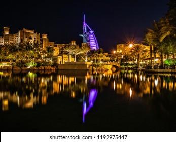 Dubai, UAE - November 15 2012 : The reflection of iconic Burj Al Arab hotel on the canal in Madinat Jumeirah hotel.
