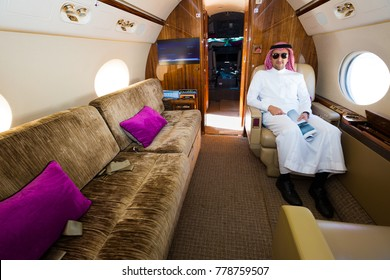 Dubai, UAE - NOVEMBER 15, 2017: Arab businessman sitting in private jet. Private airplane. Business travel. Arab sheikh. Gulfstream G450. Luxury interior.