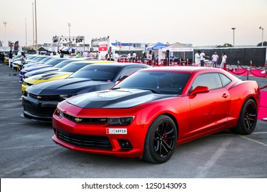 Dubai, UAE - November 15, 2018: American muscle cars Chevrolet Camaro take part in the annual Gulf Car Festival.