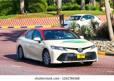 Dubai, UAE - November 15, 2018: Taxi car Toyota Camry in the city street.