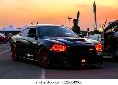 Dubai, UAE - November 15, 2018: Black sports car Dodge Charger SRT takes part in the annual Gulf Car Festival.