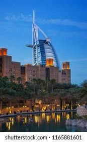 DUBAI, UAE - NOVEMBER 15: View of the hotel Burj Al Arab from Souk Madinat Jumeirah. Nov 15, 2012 in Dubai. Burj Al Arab is a luxury 7 stars hotel built  in front of Jumeirah beach.