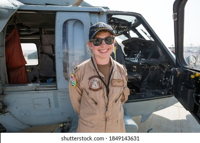 Dubai, UAE - NOVEMBER 16, 2017:  Portrait of female US Army soldier pilot standing near the helicopter