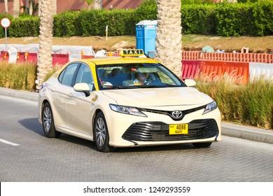 Dubai, UAE - November 16, 2018: Taxi car Toyota Camry in the city street.