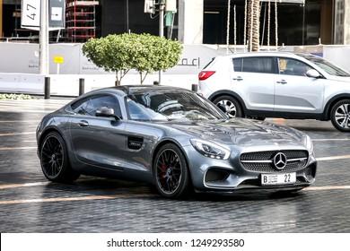 Dubai, UAE - November 16, 2018: Grey sportscar Mercedes-Benz AMG GT in the city street.