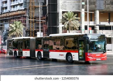 Dubai, UAE - November 16, 2018: Articulated city bus Neoplan N4522/3 Centroliner Evolution in the city street.