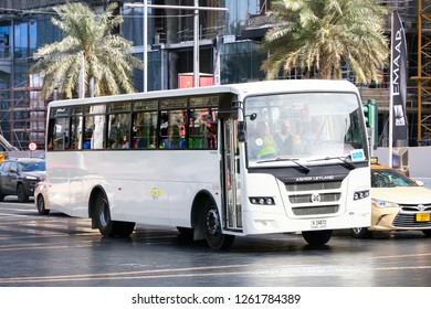 Dubai, UAE - November 16, 2018: Suburban bus Ashok Leyland Falcon in the city street.