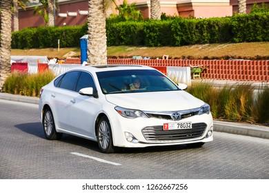Dubai, UAE - November 16, 2018: White motor car Toyota Avalon in the city street.