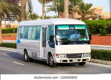 Dubai, UAE - November 16, 2018: Small bus Mitsubishi Fuso Rosa in the city street.