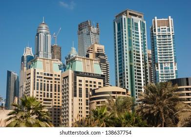 DUBAI, UAE - NOVEMBER 16: Modern buildings in Dubai Marina, on November 16, 2012, Dubai, UAE. Dubai was the fastest developing city in the world between 2002 and 2008.