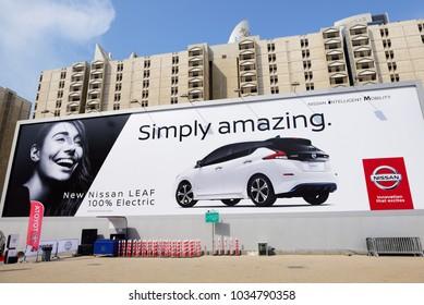 DUBAI, UAE - NOVEMBER 18: The billboard advertising of all new Nissan 2018 Leaf electric car on Dubai Motor Show 2017 on November 18, 2017