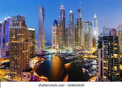 DUBAI, UAE - NOVEMBER 2: Dubai Marina at Dusk from the top, on November 2, 2013, Dubai, UAE. In the city of artificial channel length of 3 kilometers along the Persian Gulf.
