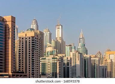DUBAI, UAE - NOVEMBER 2: Modern buildings in Dubai, on November 2, 2013, Dubai, UAE. Dubai was the fastest developing city in the world between 2002 and 2008.