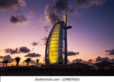 Dubai, UAE - NOVEMBER 21, 2018: Dubai skyline. Burj Al Arab iconic Dubai 7 star hotel. Famous luxury hotel. Spectacular sunset sky. Iconic symbol of Dubai.