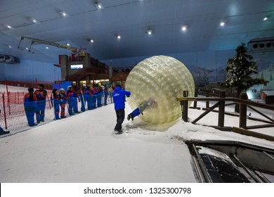 DUBAI, UAE - NOVEMBER 21, 2018: Ski Dubai indoor ski resort. Mall of the Emirates. Snow resort in Dubai. Iconic Dubai place. Snow activities. Kids playing. Zorbing. Winter activities. Family fun.