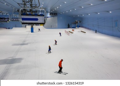 DUBAI, UAE - NOVEMBER 21, 2018: Ski Dubai indoor ski resort. People skiing. Ski lift. Mall of the Emirates. Snow resort in Dubai. Iconic Dubai place. Snow activities. Winter activities. Family fun.