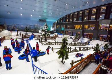 DUBAI, UAE - NOVEMBER 21, 2018: Ski Dubai indoor ski resort. Mall of the Emirates. Snow resort in Dubai. Iconic Dubai place. Snow activities. Kids playing. Winter activities. Family fun.