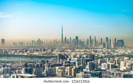 DUBAI, UAE - NOVEMBER 22, 2015: City skyline and buildings. Dubai attracts more than 10 million visitors annually.