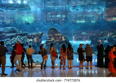 DUBAI, UAE - NOVEMBER 22, 2017: Shoppers visit the Aquarium at Dubai Mall. It is the largest mall in the world by total area with 502,000 square metres retail area.