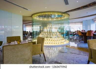 DUBAI, UAE - NOVEMBER 22, 2018: Dubai luxury hotel. Hotel interior. Gevora, the tallest hotel in the world.  Restaurant interior. Luxury interior. Modern chandelier. Chandelier of hotel restaurant.