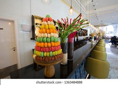DUBAI, UAE - NOVEMBER 22, 2018: Macaroons, cookies, biscuits.  Restaurant interior. Bar, cafe.