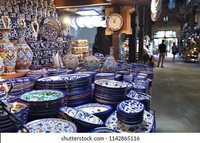 DUBAI, UAE - NOVEMBER 23, 2017: Souvenir shop at Souk Madinat Jumeirah in Dubai. The traditional Arab style bazaar is part of Madinat Jumeirah resort.