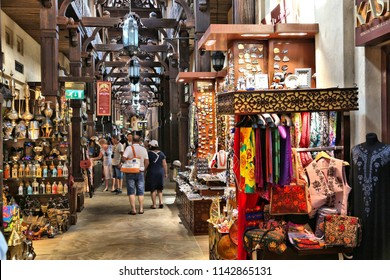 DUBAI, UAE - NOVEMBER 23, 2017: People shop at Souk Madinat Jumeirah in Dubai. The traditional Arab style bazaar is part of Madinat Jumeirah resort.