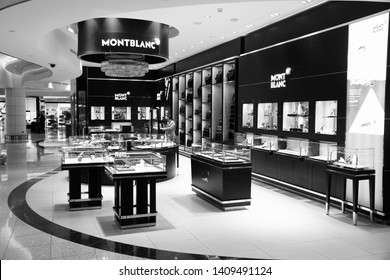 DUBAI, UAE - NOVEMBER 23, 2017: People shop at Montblanc store at Dubai International Airport, United Arab Emirates. The German brand Montblanc is famous for pens, watches and jewellery.