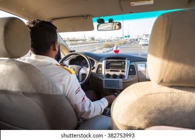 DUBAI, UAE - NOVEMBER 24 : Taxi driver in Dubai in a summer day November 24, 2015, United Arab Emirates