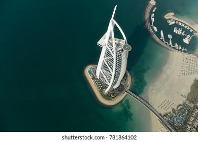 Dubai, UAE - November 25, 2012: View of the luxury beach of Dubai and Burj al-Arab, in Dubai,UAE. The Bur is the most exclusive hotel of the world, and seven star in Dubai.